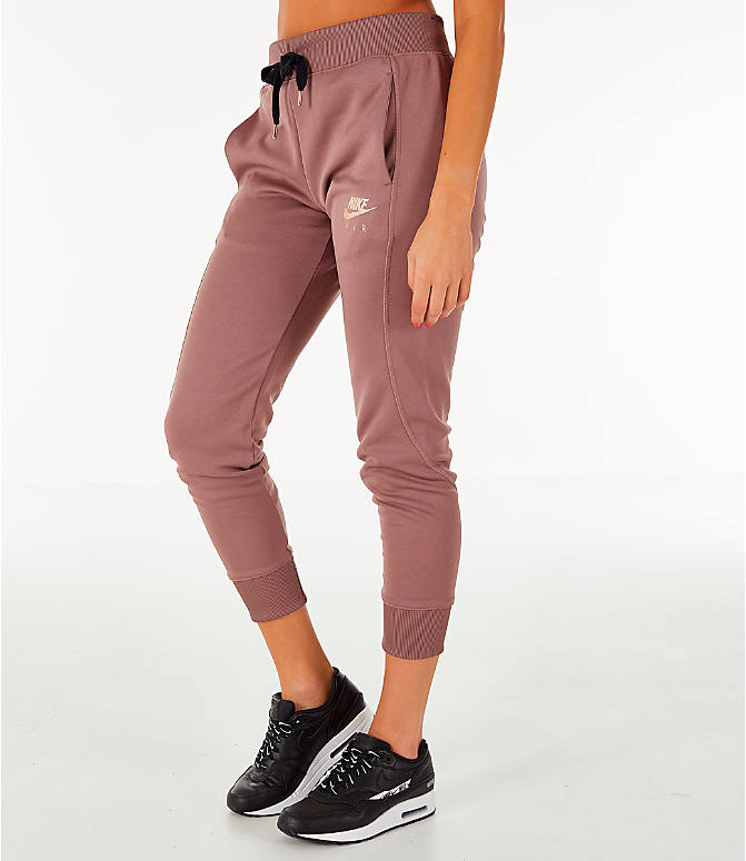 Front Three Quarter view of Women's Nike Sportswear Jogger Pants in Smokey Mauve/Rose Gold