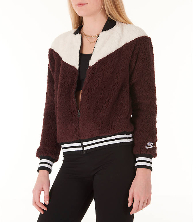 Front Three Quarter view of Women's Nike Sportswear Sherpa Wolf Bomber Jacket in Burgundy Crush/White