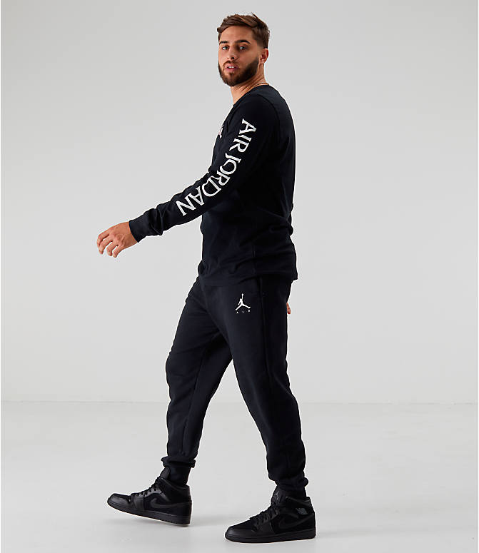 Front Three Quarter view of Men's Jordan Sportswear Jumpman Fleece Pants in Black