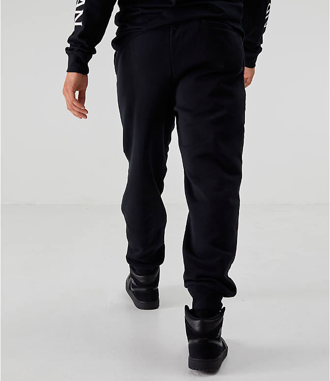 Back Right view of Men's Jordan Sportswear Jumpman Fleece Pants in Black