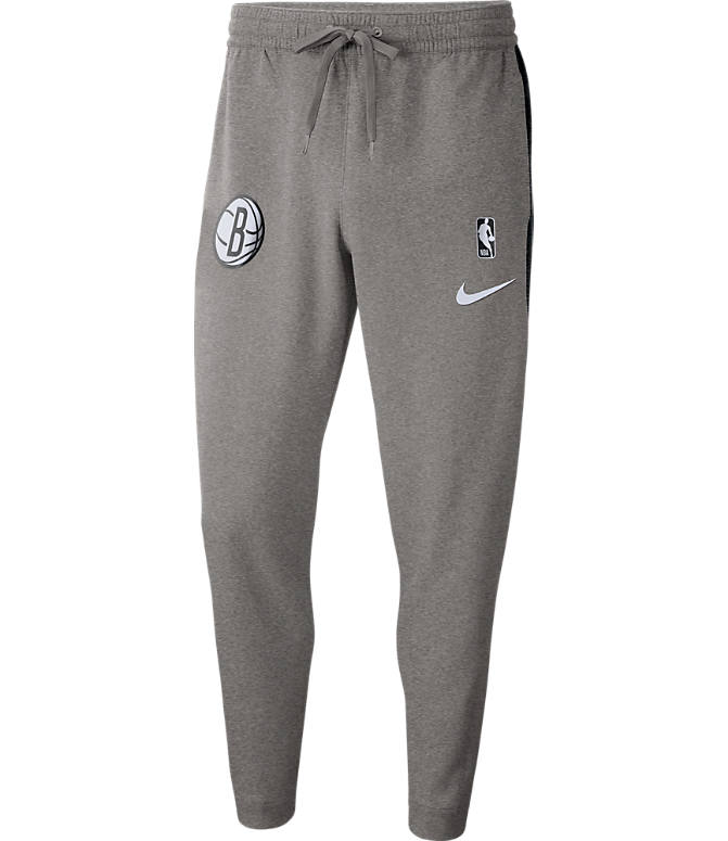 Front view of Men's Nike Brooklyn Nets NBA Dri-FIT Showtime Pants in Dark Grey Heather