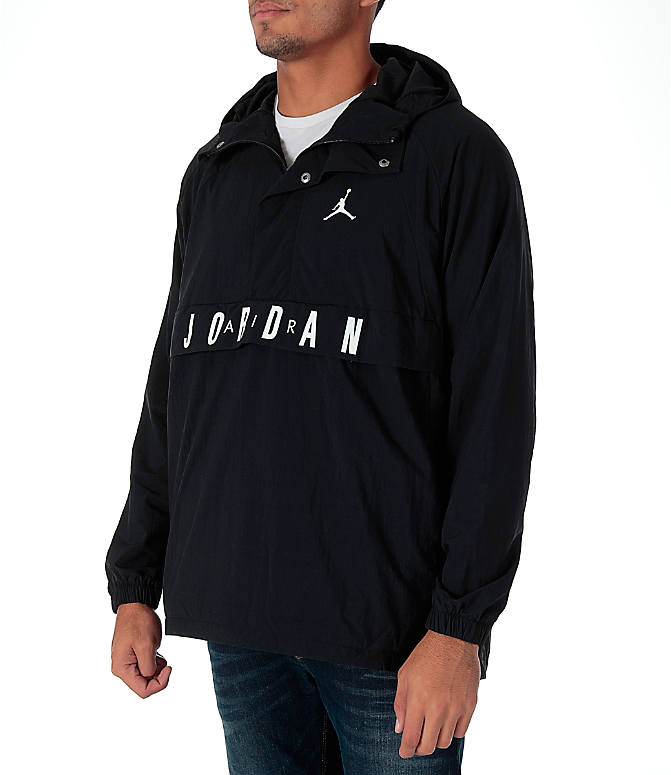 Front Three Quarter view of Men's Air Jordan Anorak Wings Wind Jacket in Black/White