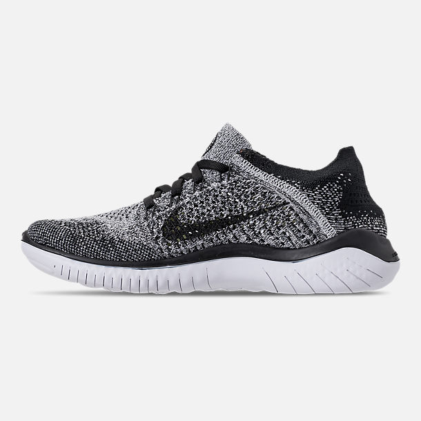 Left view of Women s Nike Free RN Flyknit 2018 Running Shoes in White Black d188917e6