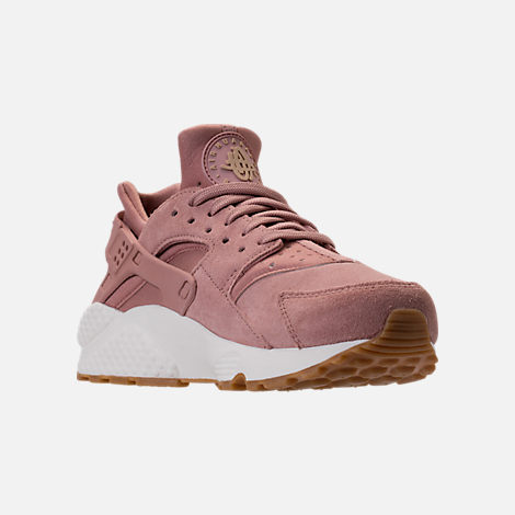 Three Quarter view of Women's Nike Air Huarache Run SD Running Shoes in Particle Pink/Gum Medium Brown/Ivory
