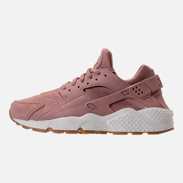 Left view of Women's Nike Air Huarache Run SD Running Shoes in Particle Pink/Gum Medium Brown/Ivory