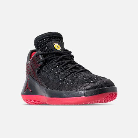 Three Quarter view of Boys' Grade School Air Jordan XXXII Low Basketball Shoes in Black/Varsity Red/Tour Yellow