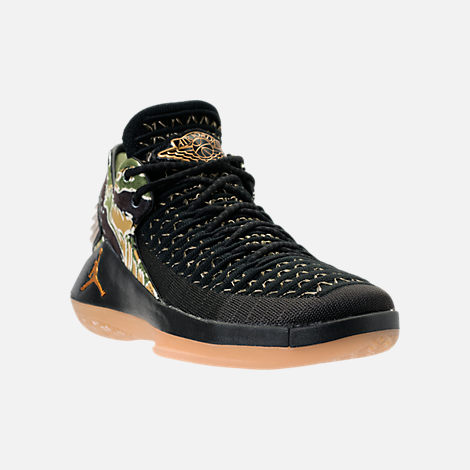 Three Quarter view of Boys' Grade School Air Jordan XXXII Low Basketball Shoes in Black/Metallic Gold/White