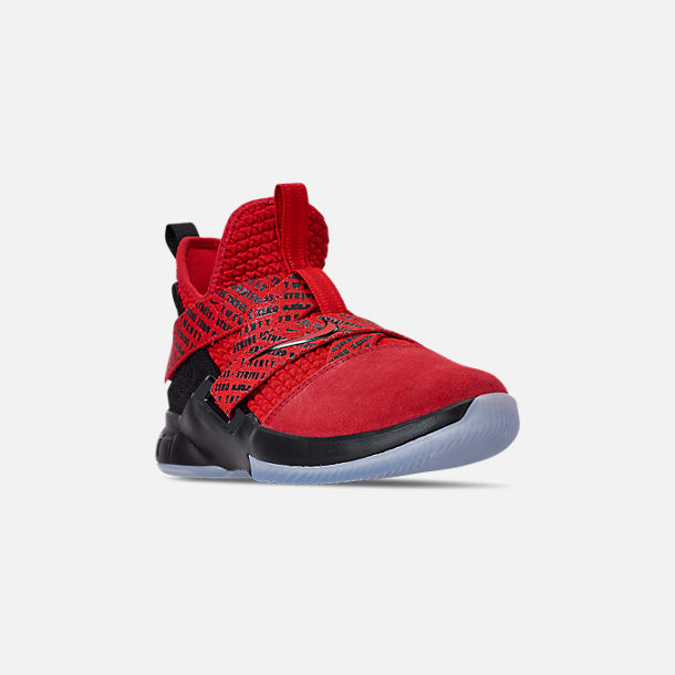 Three Quarter view of Boys' Big Kids' Nike LeBron Soldier 12 Basketball Shoes in Red/Black