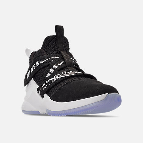 Three Quarter view of Boys' Little Kids' Nike LeBron Soldier 12 Basketball Shoes in Black/White