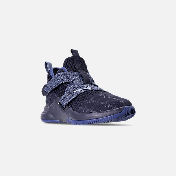 Three Quarter view of Boys' Little Kids' Nike LeBron Soldier 12 Basketball Shoes in Blackened Blue/Work Blue/Gym Blue