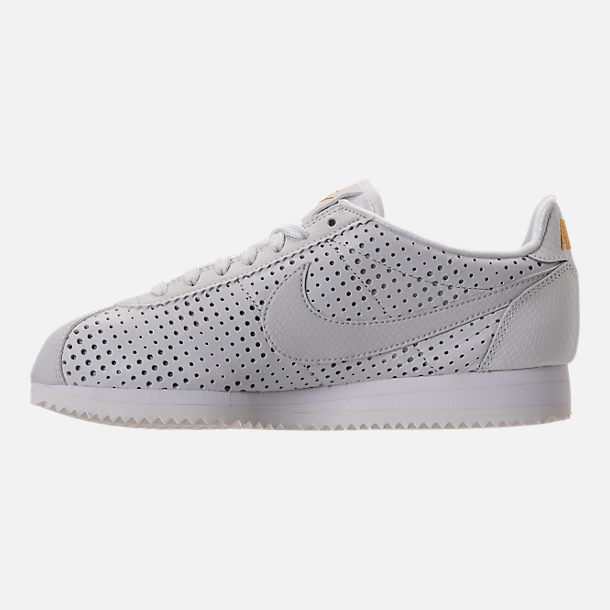 Left view of Women's Nike Cortez Classic SE Premium Casual Shoes in Summit White/White Metallic