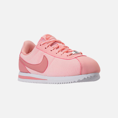Three Quarter view of Girls' Big Kids' Nike Cortez Basic Textile SE Casual Shoes in Storm Pink/Rust Pink/White
