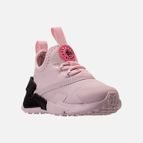 Three Quarter view of Girls' Toddler Nike Huarache Drift Casual Shoes in Barely Rose/Coral Chalk/White