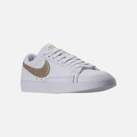 Three Quarter view of Women's Nike Blazer Low LE Casual Shoes in White/Metallic Gold Star/White