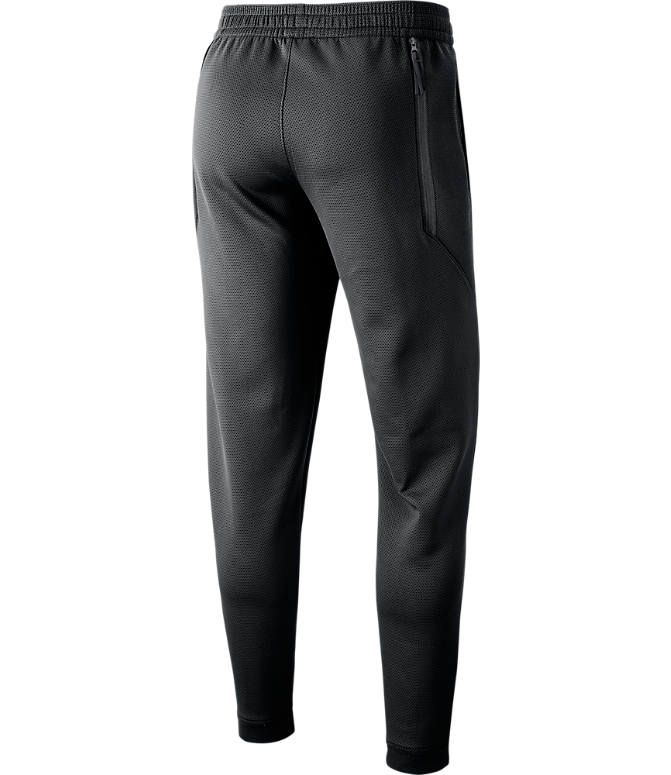 Back view of Men's Nike New York Knicks NBA Showtime Therma Flex Pants in Black