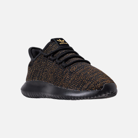 Three Quarter view of Girls' Grade School adidas Tubular Casual Shoes in Black/Gold/Metallic