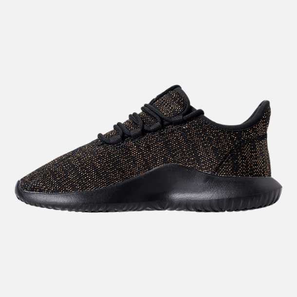 Left view of Girls' Grade School adidas Tubular Casual Shoes in Black/Gold/Metallic