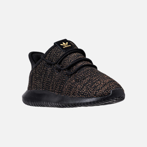 Three Quarter view of Girls' Preschool adidas Tubular Casual Shoes in Black/Gold Metallic