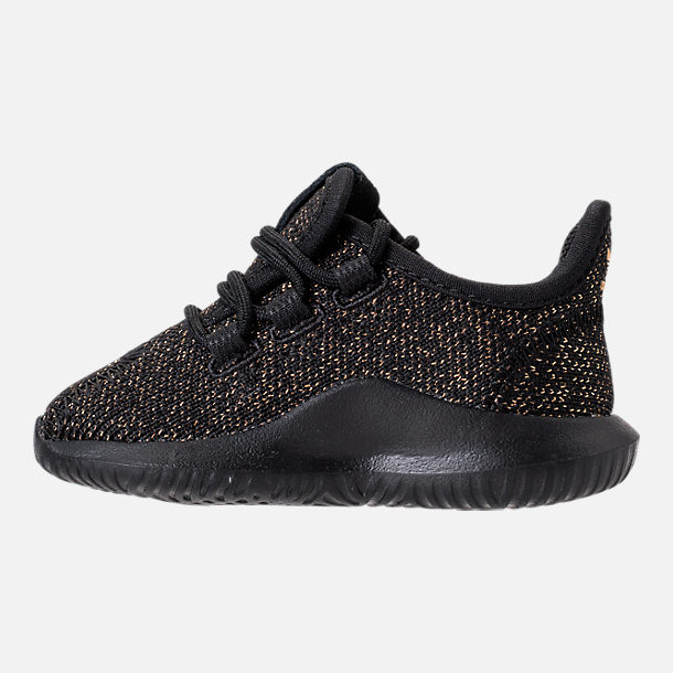 Left view of Girls' Toddler adidas Tubular Casual Shoes in Black/Gold Metallic