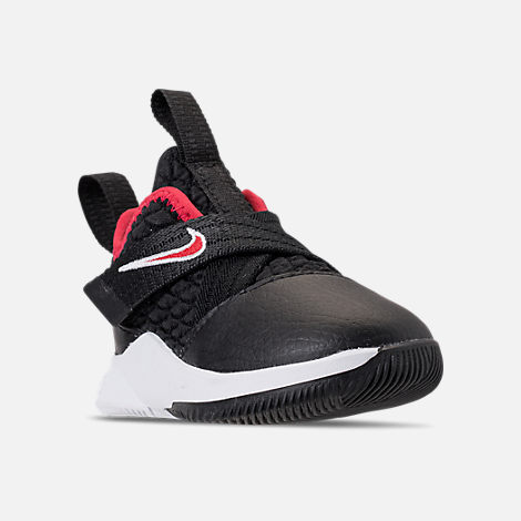 Three Quarter view of Boys' Toddler Nike LeBron Soldier 12 Basketball Shoes in Black/University Red/White