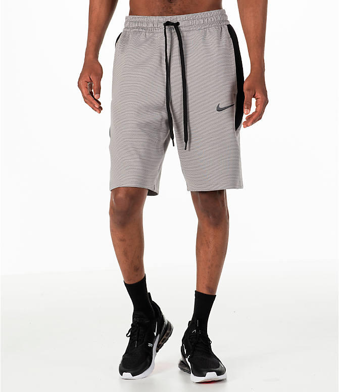 Front Three Quarter view of Men's Nike Therma Flex Showtime Basketball Shorts in Atmosphere Grey/Black