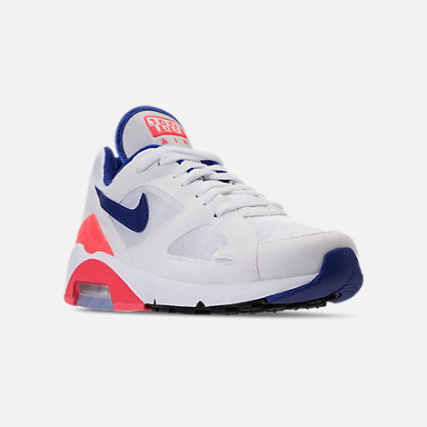 Three Quarter view of Women's Nike Air Max 180 Casual Shoes in White/Solar Red/Black/Racer Blue