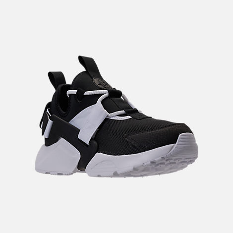 Three Quarter view of Women's Nike Air Huarache City Low Casual Shoes in Black/Black/White