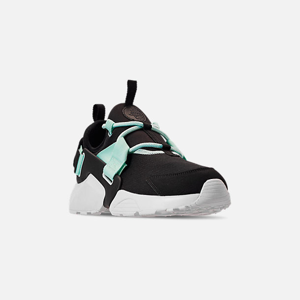 Three Quarter view of Women's Nike Air Huarache City Low Casual Shoes in Black/Igloo/White