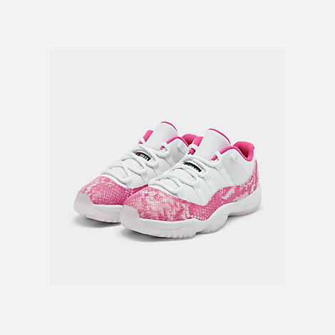Three Quarter view of Women's Air Jordan Retro 11 Low Basketball Shoes in White/Black/Rust Pink