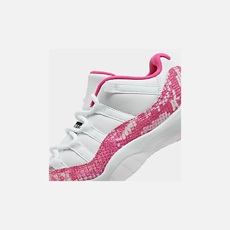 Front view of Women's Air Jordan Retro 11 Low Basketball Shoes in White/Black/Rust Pink