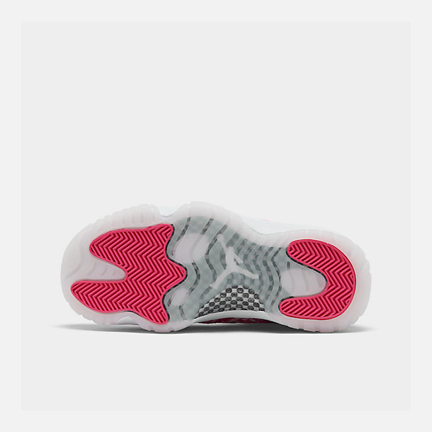 Bottom view of Women's Air Jordan Retro 11 Low Basketball Shoes in White/Black/Rust Pink