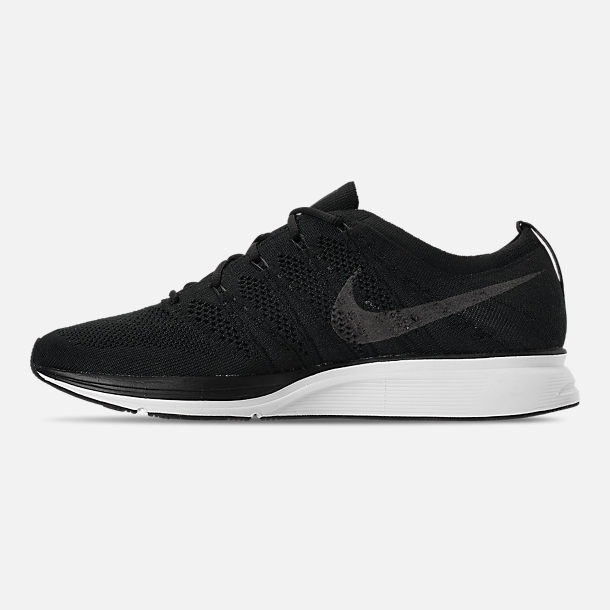 Left view of Men's Nike Flyknit Trainer Running Shoes in Black/White