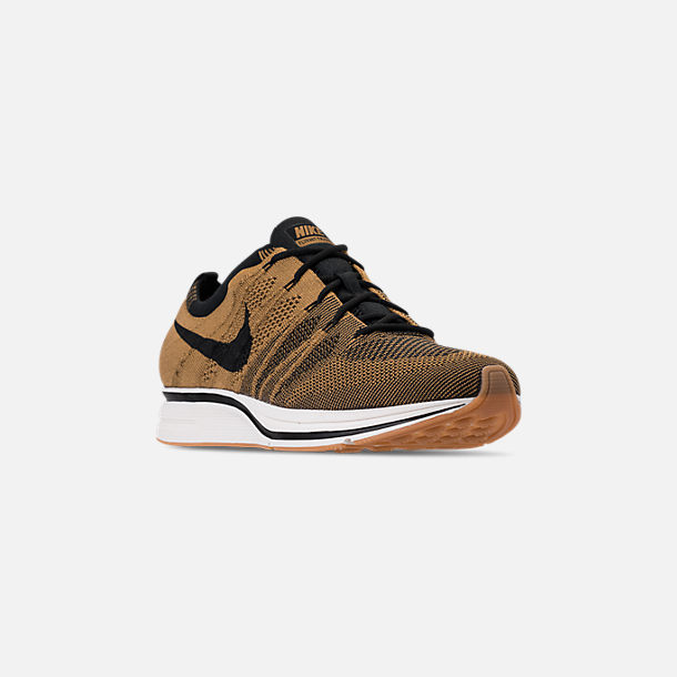 3545a9a39d84 Three Quarter view of Men s Nike Flyknit Trainer Running Shoes in Golden  Beige Black