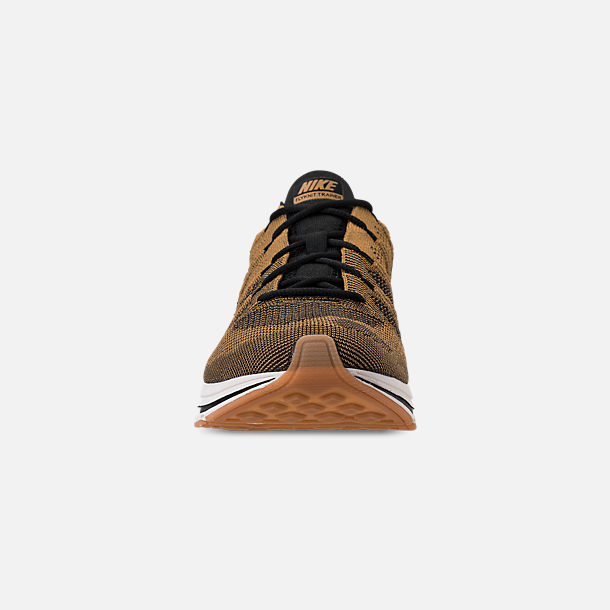 1ede78a130fd Front view of Men s Nike Flyknit Trainer Running Shoes in Golden  Beige Black Gum