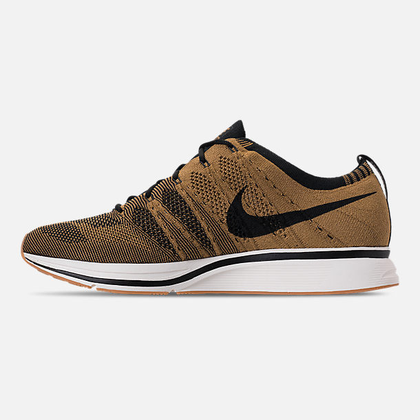 6f8be281a710 Left view of Men s Nike Flyknit Trainer Running Shoes in Golden  Beige Black Gum