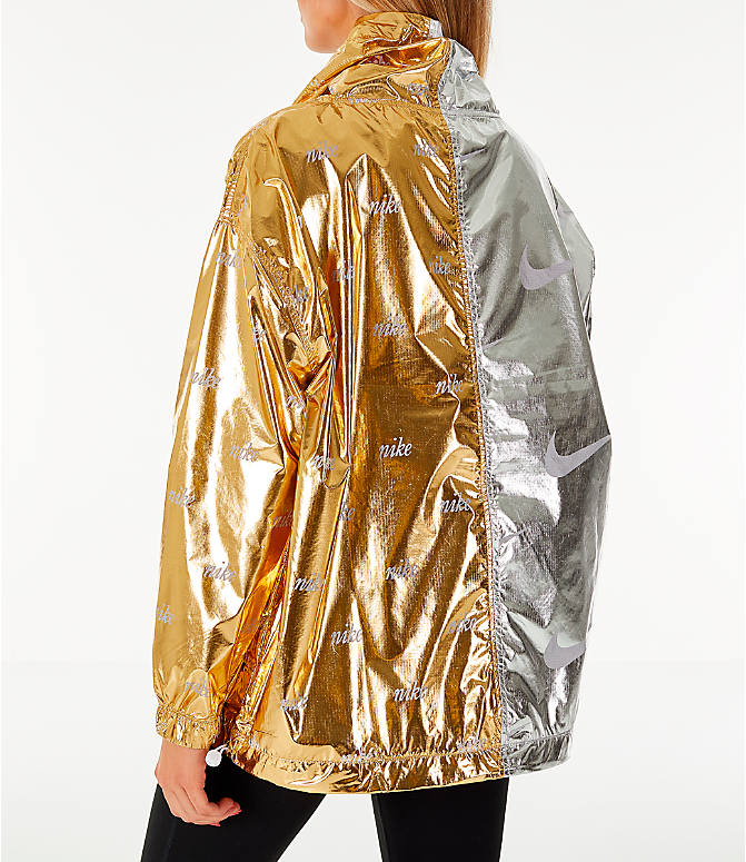 Back Left view of Women's Nike Sportswear Metallic Flash Wind Jacket in Gold/Silver