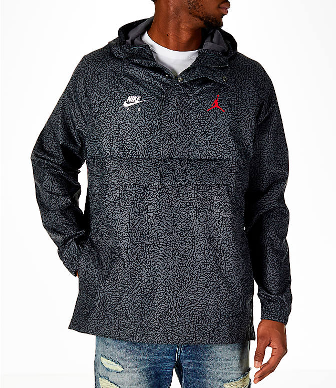 Front view of Men's Jordan Sportswear Wings 1988 Anorak Jacket in Dark Grey/Gym Red