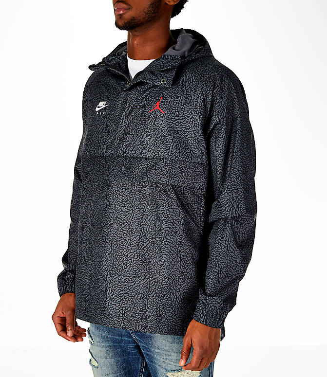 Front Three Quarter view of Men's Jordan Sportswear Wings 1988 Anorak Jacket in Dark Grey/Gym Red