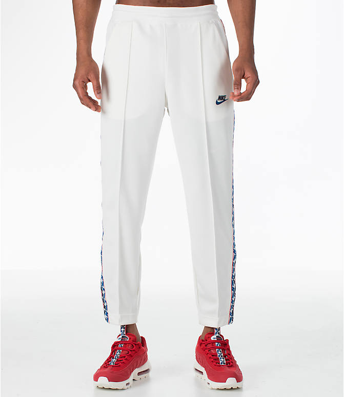 Front Three Quarter view of Men's Nike Sportswear AM Taped Track Pants in Sail
