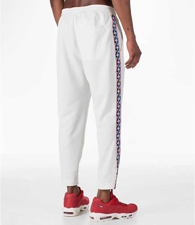 Back Right view of Men's Nike Sportswear AM Taped Track Pants in Sail