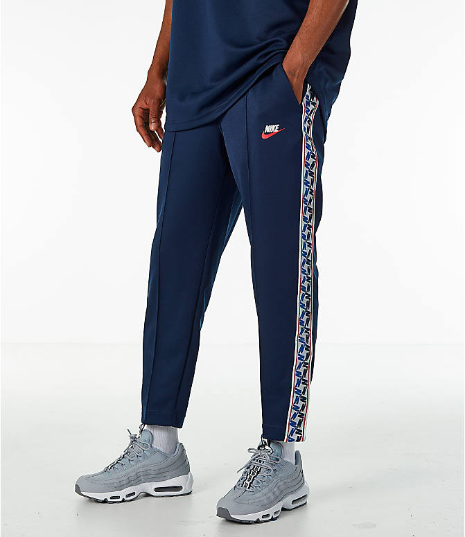 Front view of Men's Nike Sportswear AM Taped Track Pants