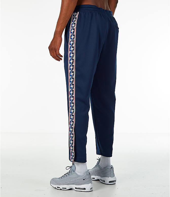 Back Left view of Men's Nike Sportswear AM Taped Track Pants