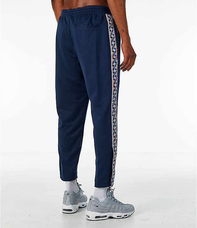 Back Right view of Men's Nike Sportswear AM Taped Track Pants