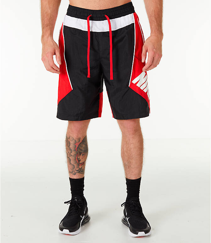 Front Three Quarter view of Men's Nike Throwback Basketball Shorts in Black/Red