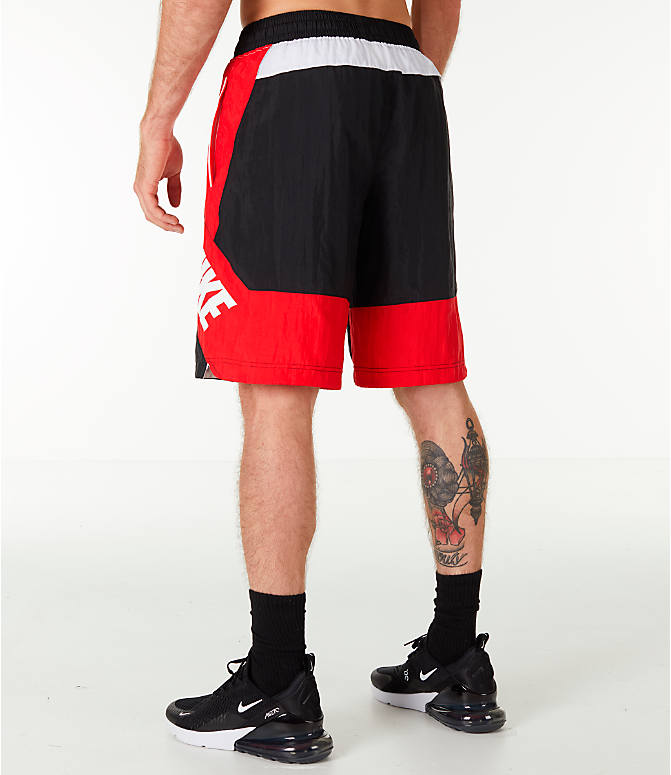 Back Left view of Men's Nike Throwback Basketball Shorts in Black/Red