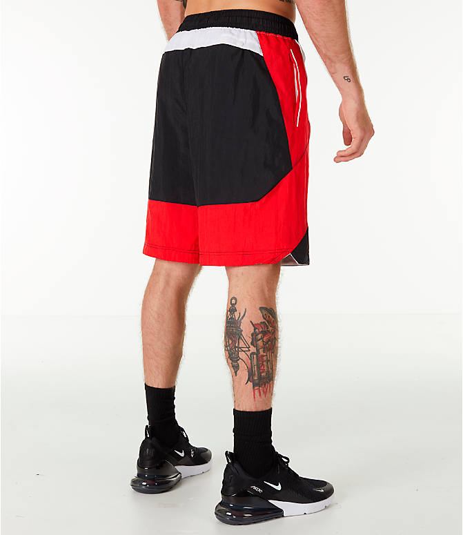 Back Right view of Men's Nike Throwback Basketball Shorts in Black/Red