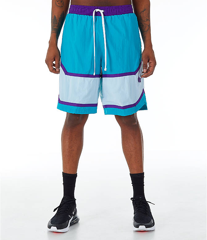 Front Three Quarter view of Men's Nike Throwback Basketball Shorts in Teal/White