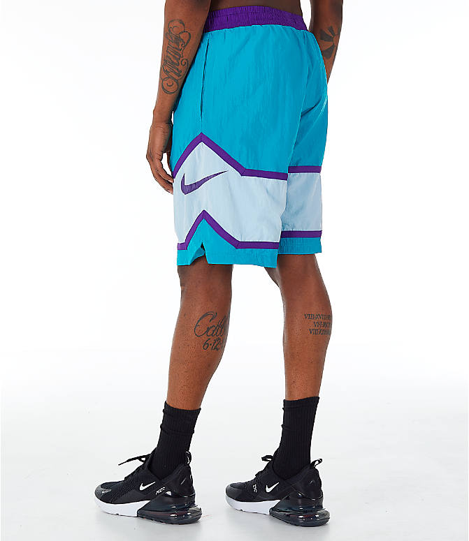 Back Left view of Men's Nike Throwback Basketball Shorts in Teal/White