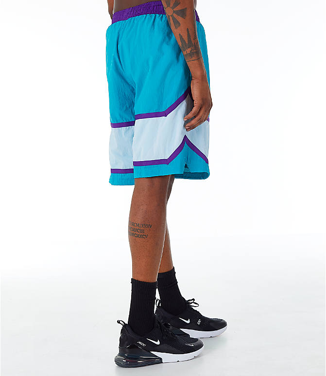 Back Right view of Men's Nike Throwback Basketball Shorts in Teal/White