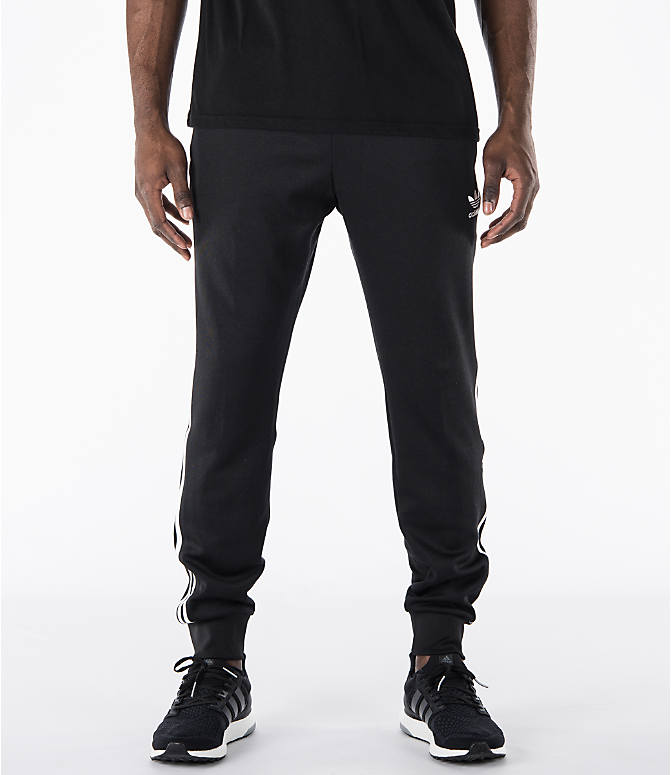 Front view of Men's adidas Originals SST Cuffed Jogger Pants in Black